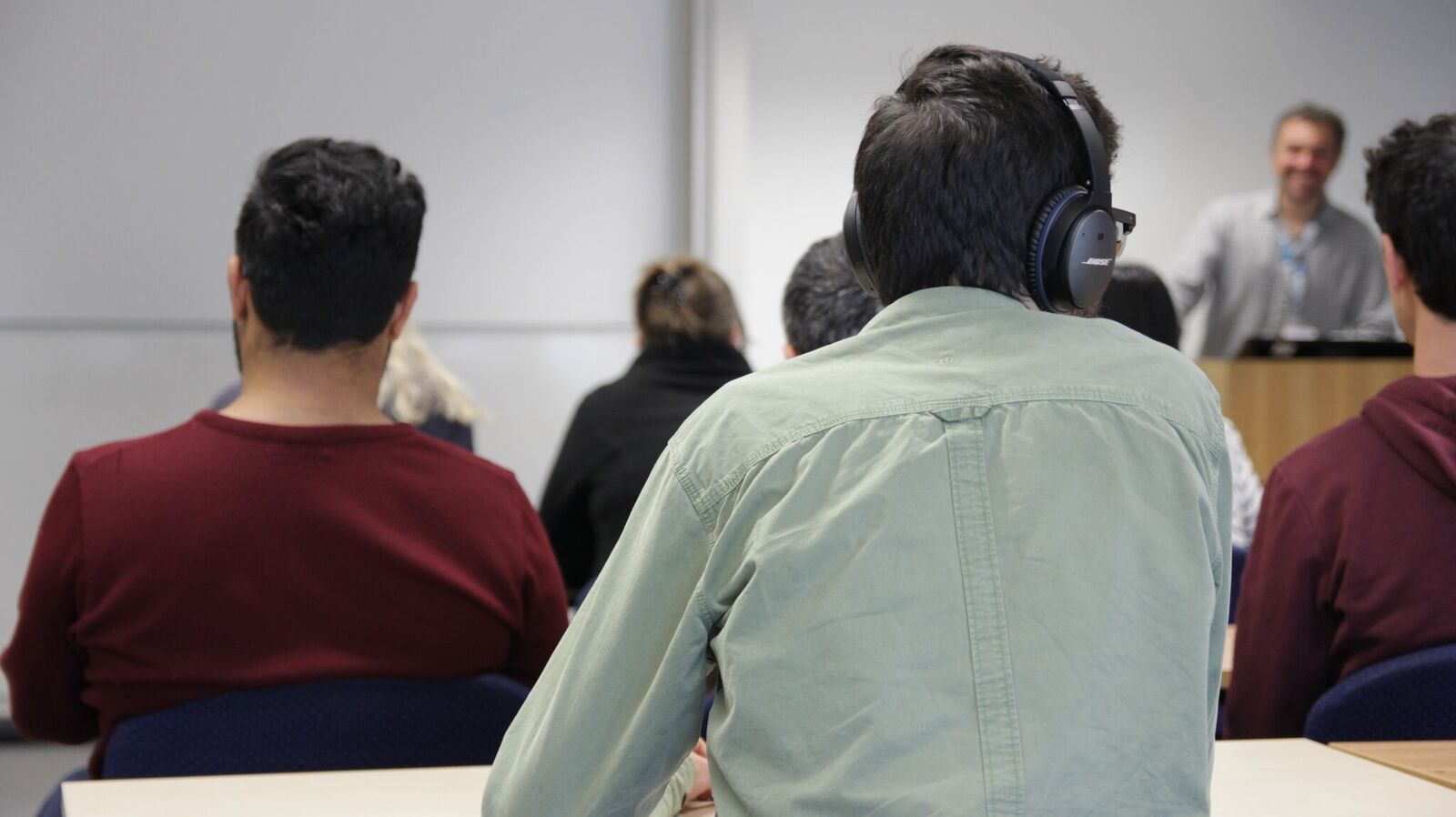 student listening with headphones to a lecture